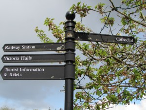 black signpost with four directions