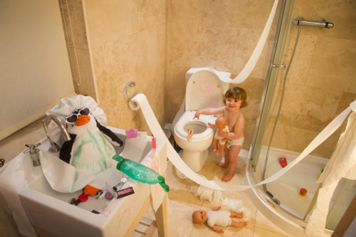 toddler making a mess of bathroom